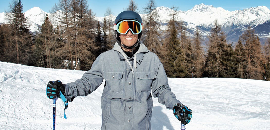 ski outerwear - smiling man wearing ski jacket