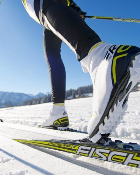 Close up on the boots and skis of a cross-country skier